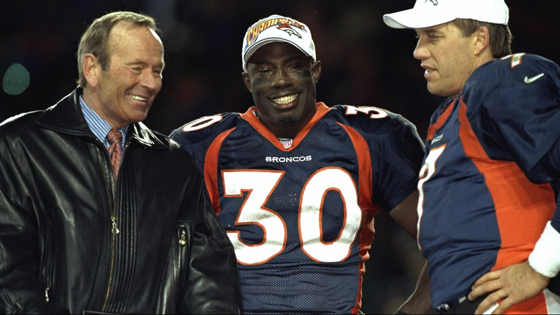 Terrell Davis stands with Pat Bowlen and John Elway after winning the AFC  Championship Game against the New York Jets at Mile High Stadium in Denver d9c4de2fd