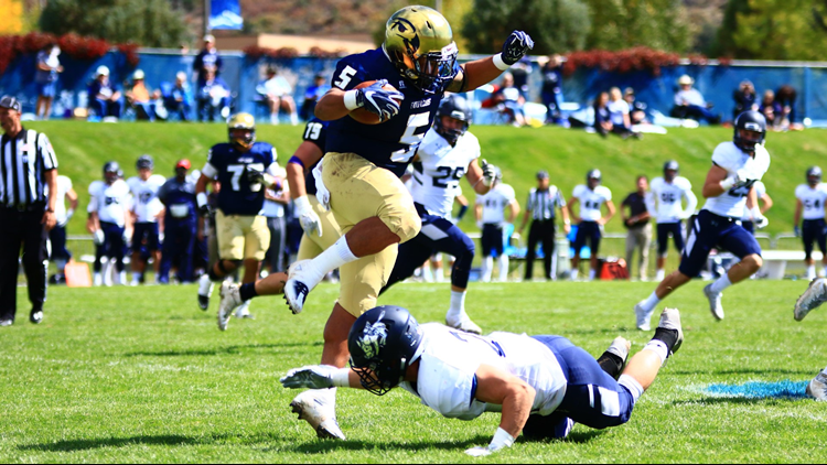 Fort Lewis College football leaping RB