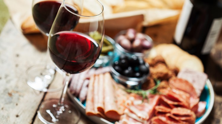 Red wine with charcuterie assortment on the backgroundRed wine with charcuterie assortment on the background italian food italy