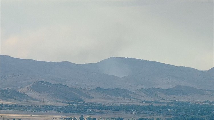Smoke was visible in Fort Collins Tuesday afternoon due to a wildfire that started burning at Seaman Reservoir.