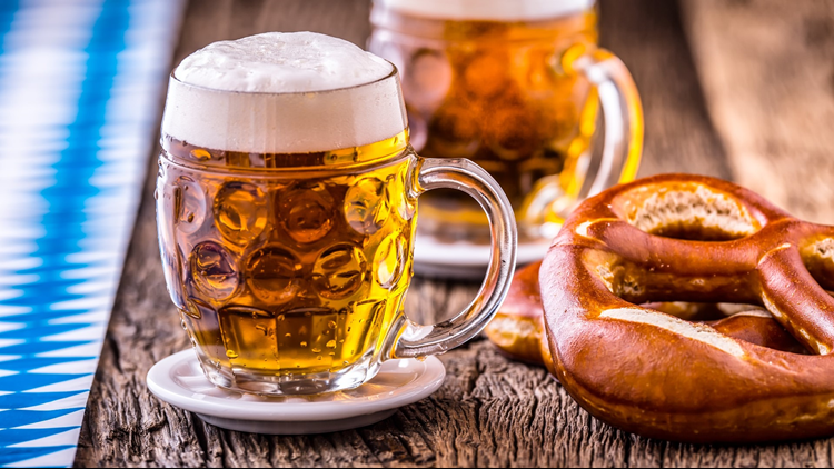 two Oktoberfest beers and pretzel