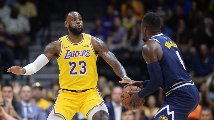 62d9a970da1 James captivates crowd in his Los Angeles Lakers debut, but Nuggets win  124-107