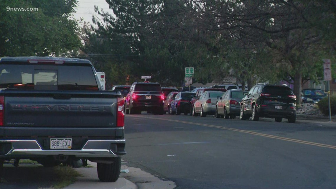 Littleton officer shot at least 3 times, search for suspect underway