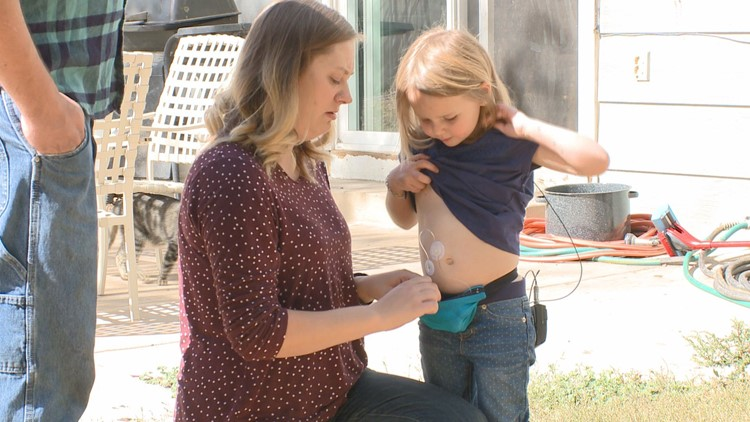 Juniper's mom helps administer Insulin to the energetic 4-year-old.