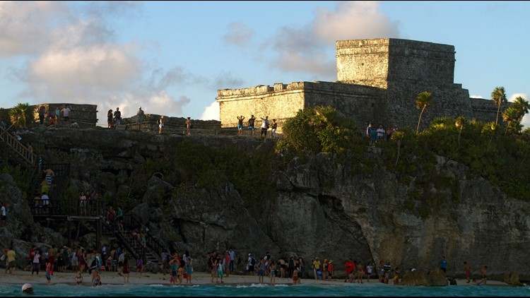 Tourists visit Tulum archaeological park, 130 km south of Cancun, Mexico on December 19, 2012.