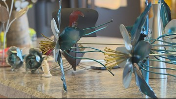 Artist creates 'Rebel Roses,' steel columbines to raise money for Dave Sanders Memorial Highway
