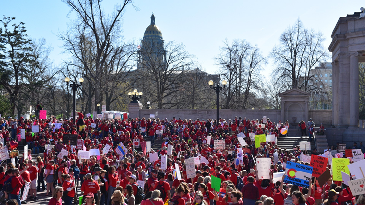 Teachers gather at Civic Center Park ahead of a rally at the Colorado State Capitol.