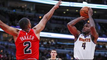 Millsap's putback gives Nuggets 108-107 win over Bulls in OT