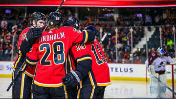 Flames score 5 straight in 3rd to rally past Avalanche 6-5