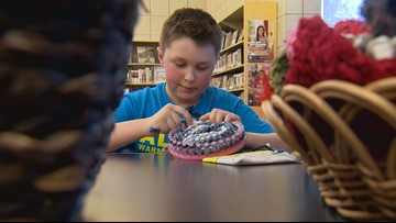 What drove this 9-year-old to knit hundreds of hats for those in need