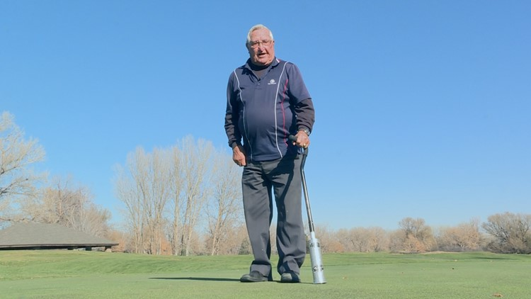 John Sabados, a part-time employee at Fox Hollow Golf Course, shows how to punch the greens.