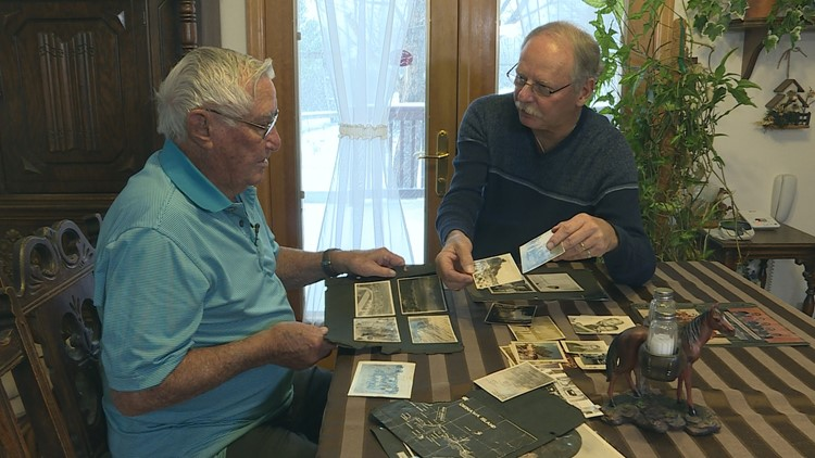 John and his oldest son, Randy, looking through old family photos.