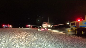 Plane goes off taxiway at DIA
