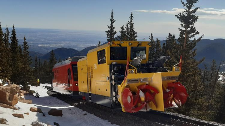Massive snow plow from Switzerland clears cog railway up Pikes Peak