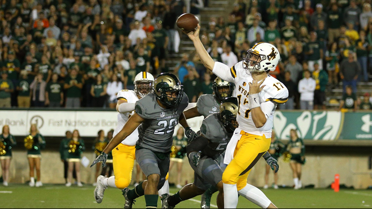 Josh Allen throws a pass under pressure from the Colorado State Rams defense during the first quarter at Sonny Lubick Field at Hughes Stadium on October 1, 2016 in Fort Collins. Photo by Justin Edmonds/Getty Images.