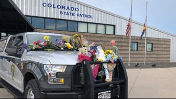 Public can leave flowers, cards on CSP trooper's car who died on duty -- it's now parked at his office
