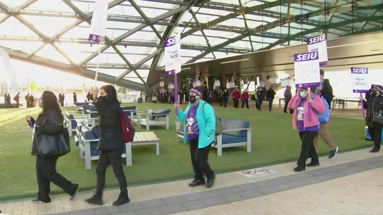 Denver airport janitors hit the picket line