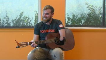 Professional guitarist visits school for a lesson in music -- and being different