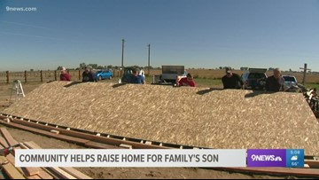 Community helps raise home for family's son