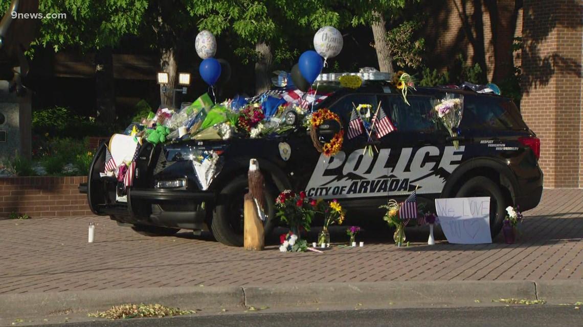 Growing memorial in Arvada for Officer Gordon Beesley