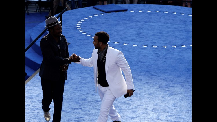 Musicians John Legend (R) and will.i.am perform on day four of the Democratic National Convention (DNC) at Invesco Field at Mile High August 28, 2008 in Denver, Colorado.