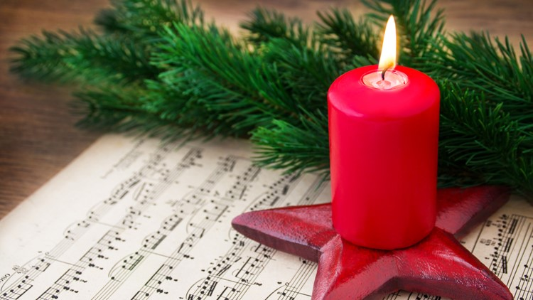 Close-up Photo Of Violin, Musical Notes and Christmas decoration burning candle christmas concert violins cellos concert symphony