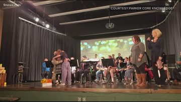 Dad returns home from deployment, surprises kids at holiday concert in Parker