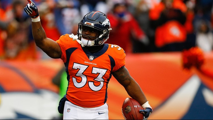 DECEMBER 31: Running back De'Angelo Henderson #33 of the Denver Broncos celebrates his first-quarter touchdown against the Kansas City Chiefs at Sports Authority Field at Mile High on December 31, 2017 in Denver, Colorado.