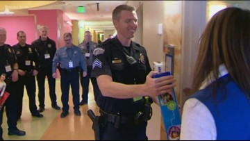 Law enforcement officers deliver hundreds of new toys to kids at Children's Hospital Colorado