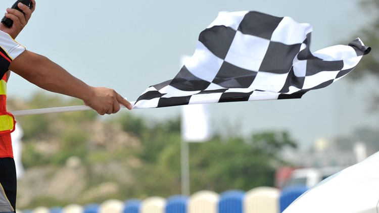 checkered race flag in hand racing motorsports