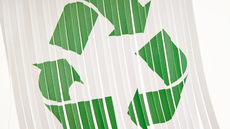 Recycling symbol on shredded paper