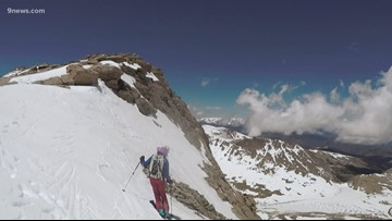 This group waits to ski Mount Evans every year, hiking to the peak with skis on their backs