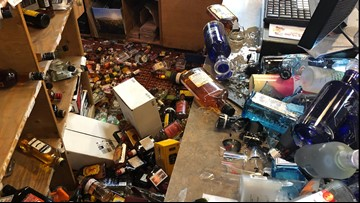 SUV crashes into Littleton liquor store
