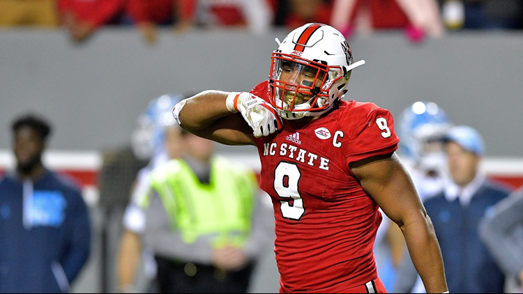 Bradley Chubb of the North Carolina State Wolfpack reacts after a win against the North Carolina Tar Heels on November 25, 2017 in Raleigh, North Carolina. Photo by Grant Halverson/Getty Images.