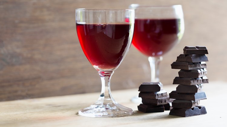 Dark chocolate and red wine on wooden background