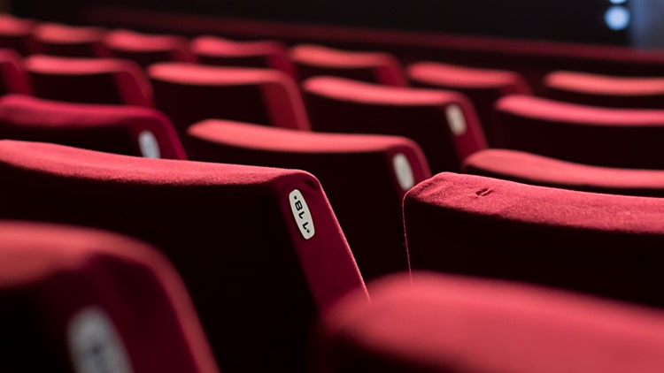 Empty theater with red chairs
