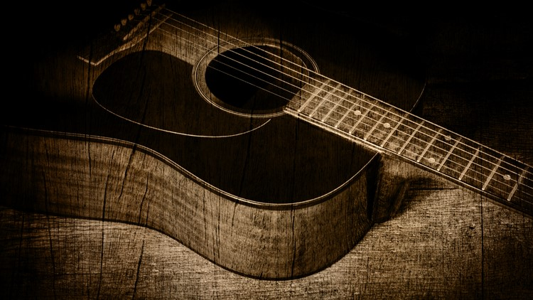 guitar in wood texture background rustic