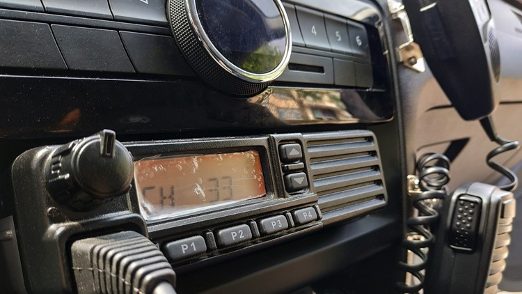 Police patrol car radio equipment and microphone. Walkie-talkie. Selective focus.