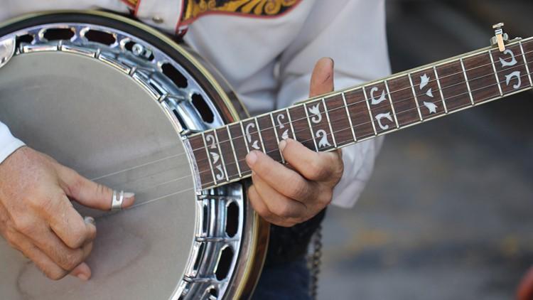 Close up guitar cowboy in the market banjo bluegrass