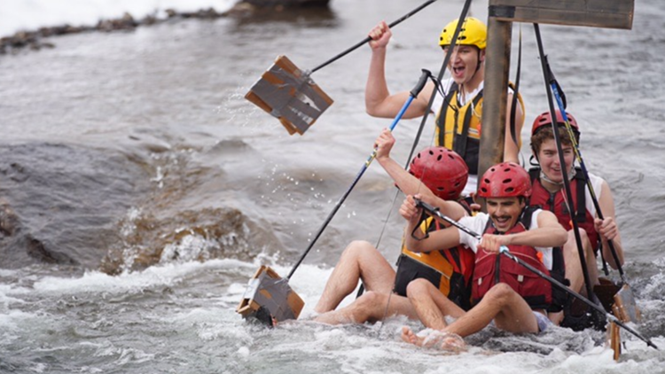 School of Mines students are floating (and capsizing) cardboard boats on Clear Creek