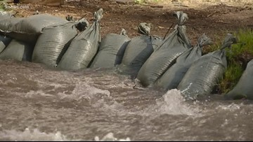 Homes filling with water, flooding threat continues in Red Cliff