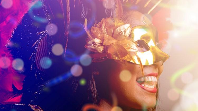 Brazilian woman wearing carnival costume mask