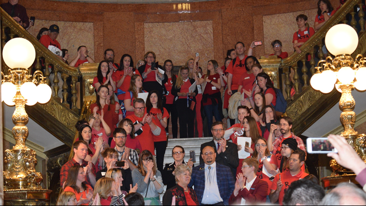 Lawmakers and teachers gathered in the Colorado State Capitol Monday for a rally sponsored by Colorado's largest teachers' union.