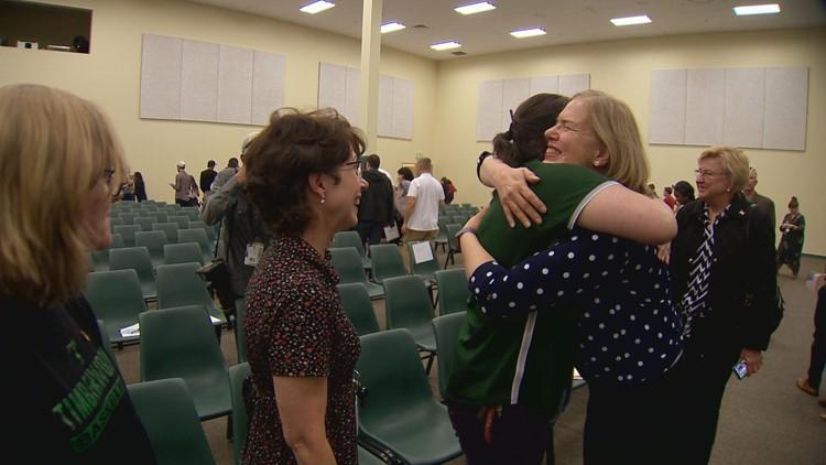 Carla hugs colleagues