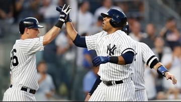 Encarnación, ex-Rockies help Yankees beat Colorado 8-2