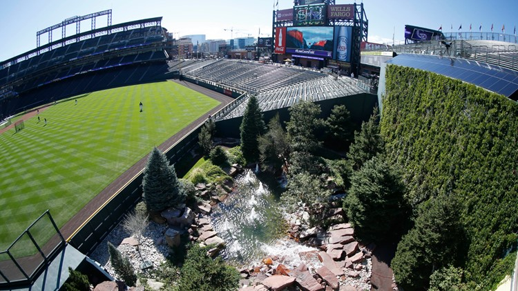 Players warm up in Coors Field outfield fountain AP