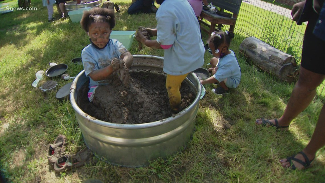 Students celebrate International Mud Day by getting a little messy