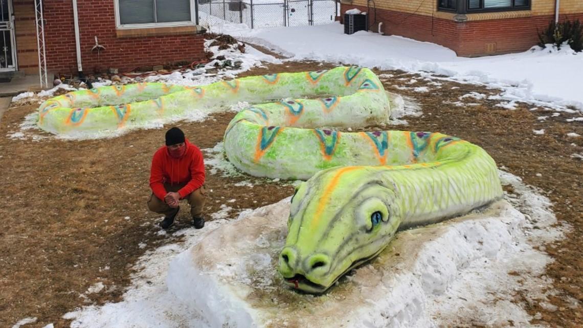 WATCH: Family builds massive snow snake in Denver's Park Hill neighborhood