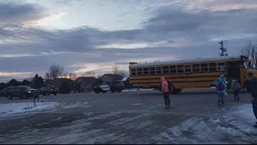 RAW: Video shows marked police car fail to stop for school bus
