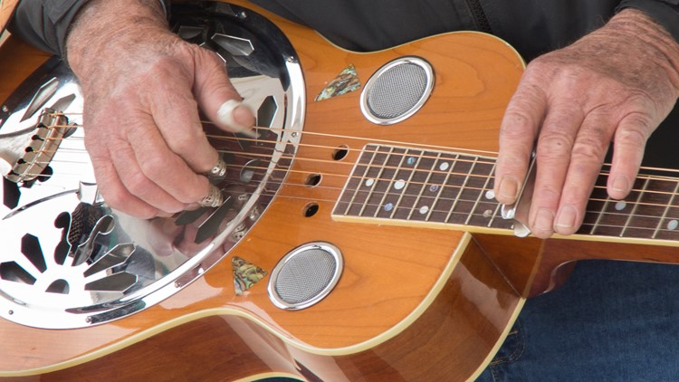 A muscian plays the Dobro in a banjo Bluegrass Band in Myrtle Beach South Carolina